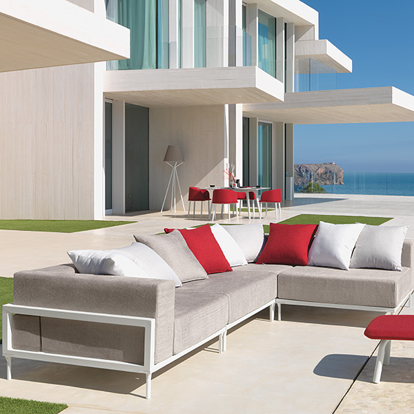 manifold possibilities: cleo modular seating with cleo pouf (throw pillows optional) | in the back to left: cleo dining | in the back to right: cleo sunbed on wheels