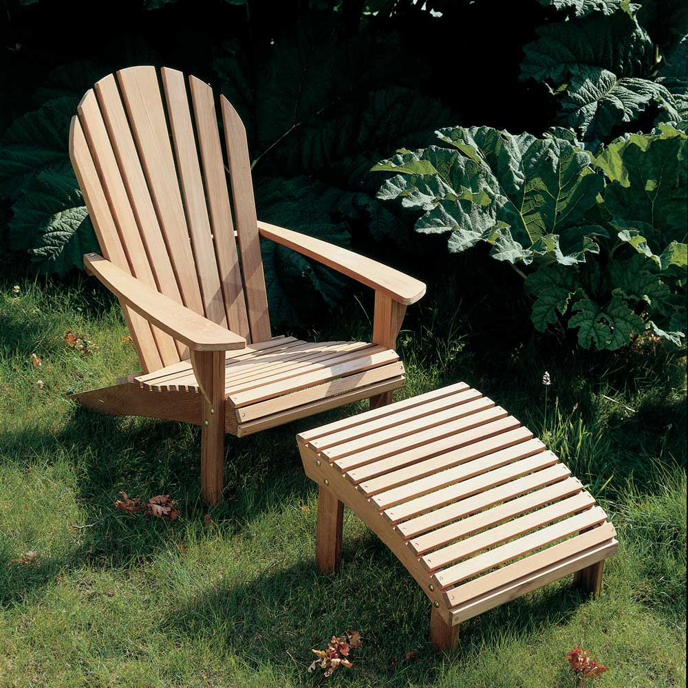 backyard oasis with an adirondack armchair with footrest