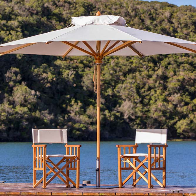 residential or commercial: safari's 8.9' round center pole umbrella will beautify any space (eucalyptus structure | sunbrella canopy in canvas | base not included)