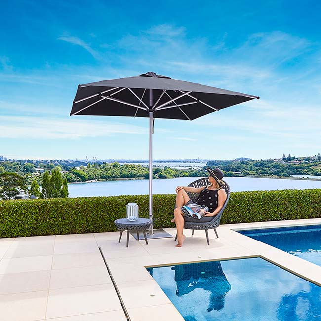 center post in black: monterey 13' giant octagonal market umbrella next to your private or public pool