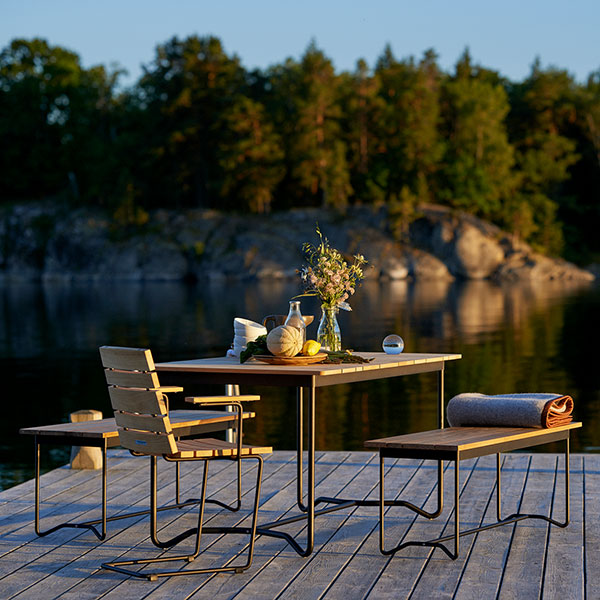 """a spot by the lake: grinda 59"""" dining table with two grinda benches and grinda armchair"""