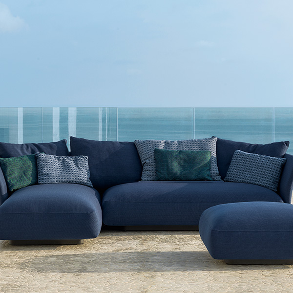 luxurious comfort: cliff sofa longue DX (left) and sofa SX (right) with pouf in blue (back & throw pillows optional)