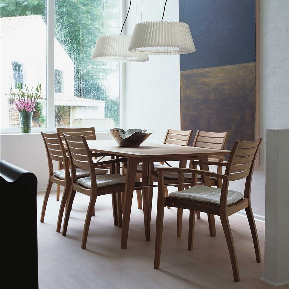 """goes indoors as well: ballare 77"""" dining table (unextended) and six dining chairs with optional barriere cushion (white)"""