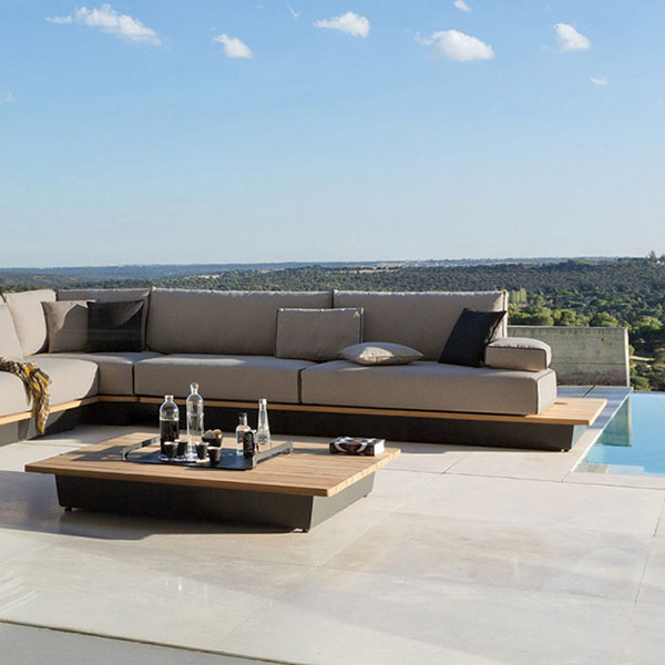 outdoor lifestyle: concept 2 shown with cushions in taupe grey lotus fabric and large iroko wood top footstool