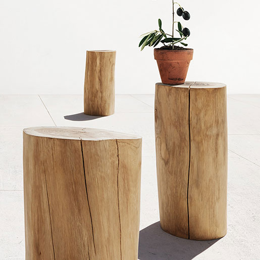 six gloster round teak log stools image provided courtesy of gloster furniture, inc.