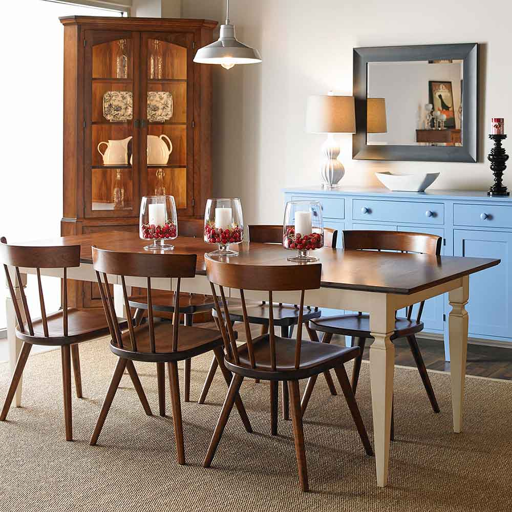 jackson two-leaf extending dining table in two-tone finish paired with lana chairs