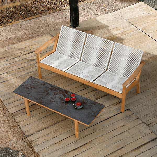 """monterey 3-seater sofa shown in chalk with 59"""" ceramic top coffee table shown in oxide"""