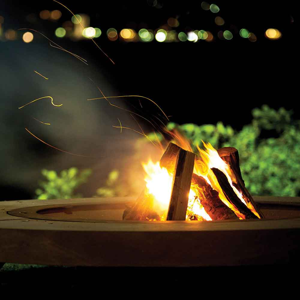 transport yourself in front of this fire: rondo outdoor fire pit with natural stone