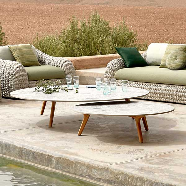 """nesting tables: 39"""" and 58"""" coffee table (frame: teak, table top: fossil) paired with kobo 1-seaters and 3-seater sofa"""