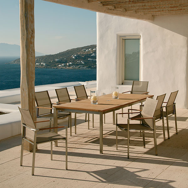 8 mercury stacking armchairs w/ dining table out of barlow tyrie's equinox line
