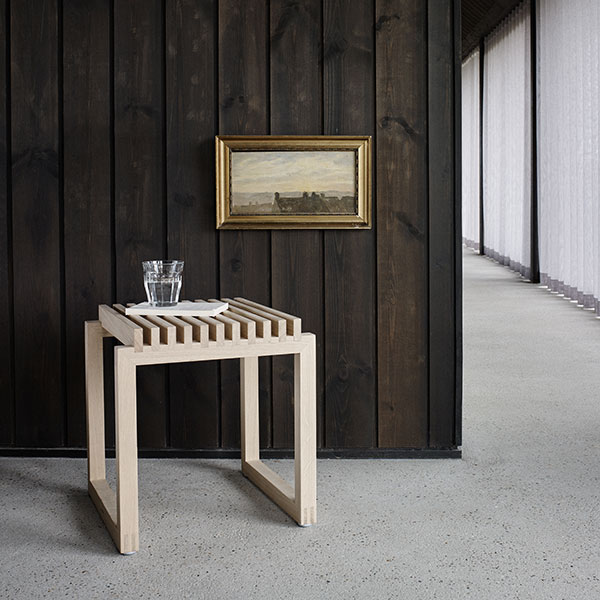 versatile: cutter stool in oak can be used for many things
