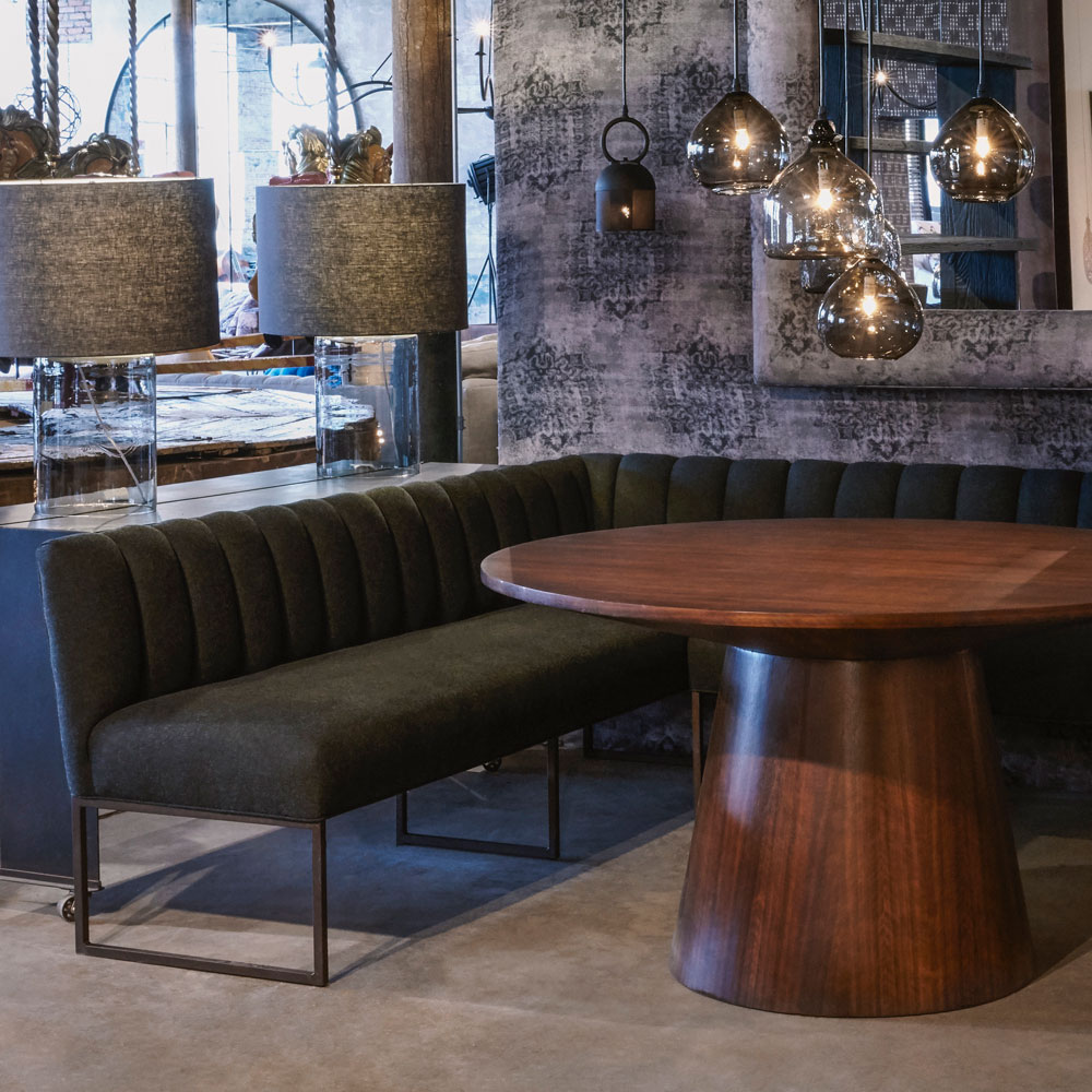 enzo banquette in naoki fern fits nicely with a round dining table