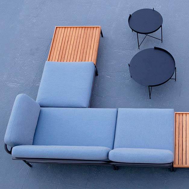 complementing many outdoor settings: edge tray tables in three different sizes and heights for flexibility (powder-coated metal, black) paired with houe's level sectional in sunbrella fabric (natte, dusty blue)
