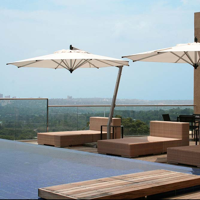 elegant shade solution: 10.5' picollo round cantilever in sunbrella natural canopy
