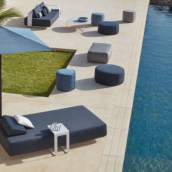 add manutti's touch poufs to your outdoor setting: round or rectangular