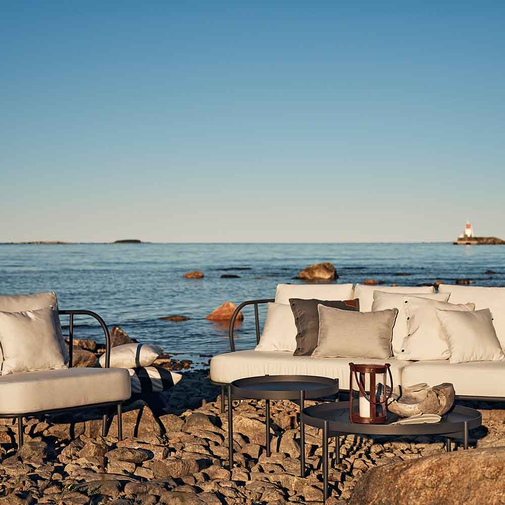 coastal views: salto sofa, lounge chair with lounge tables and skargaarden's marstrand lantern