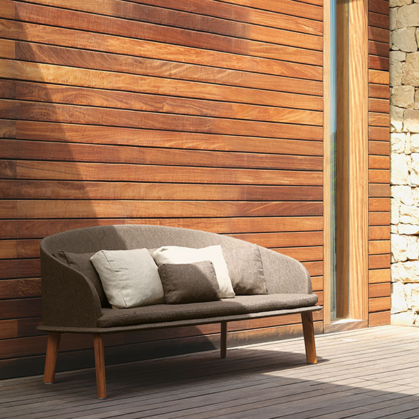 a one-piece statement: cleo love seat in teak and bronze mélange (all pillows included in price)