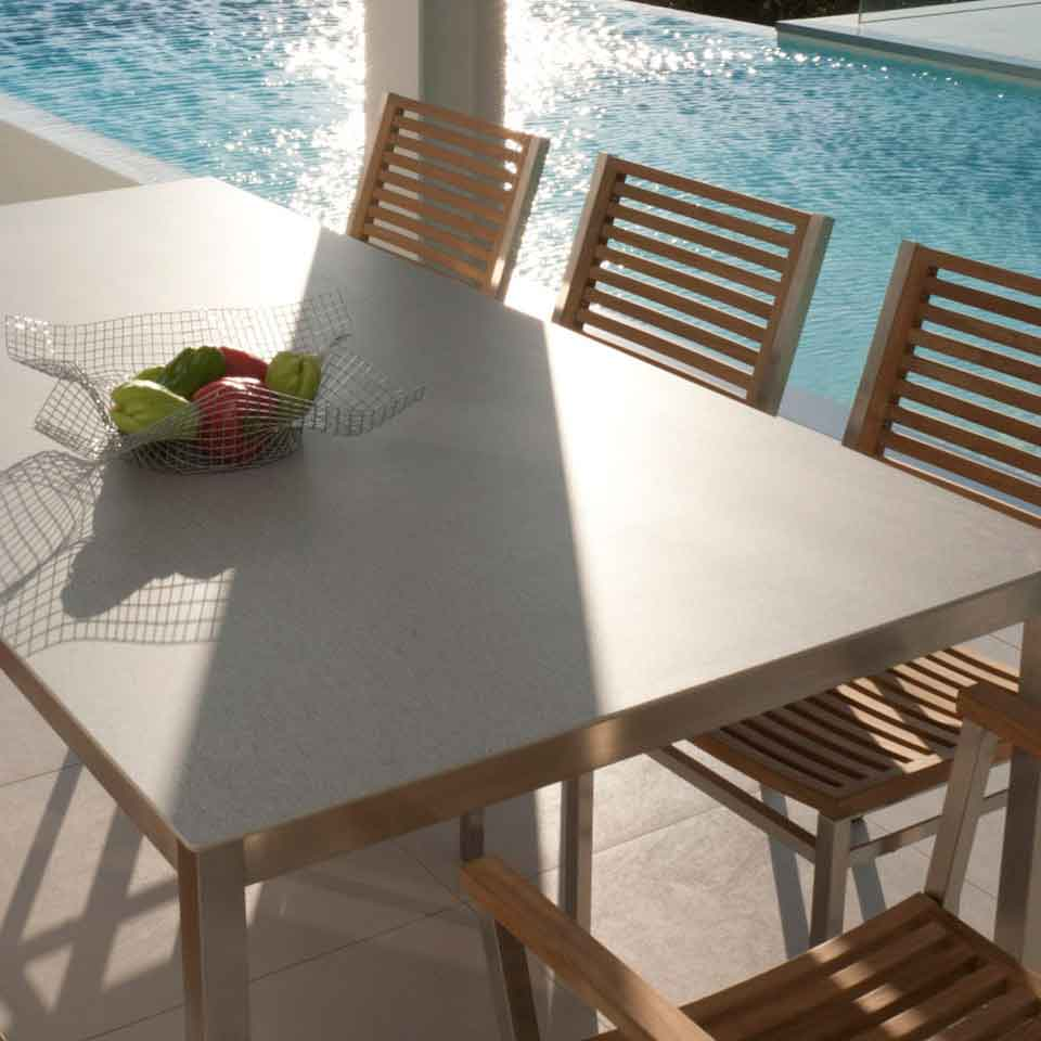 """tabletops make a difference: equinox 79"""" ceramic top dining table in frost with equinox teak armchairs"""