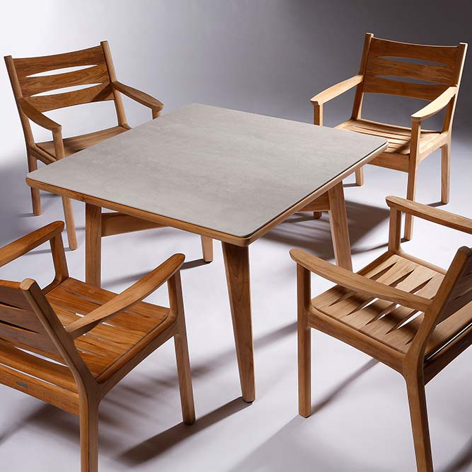 """a table for four: four monterey all teak armchairs paired with monterey's 40"""" dining table with a frost ceramic tabletop"""