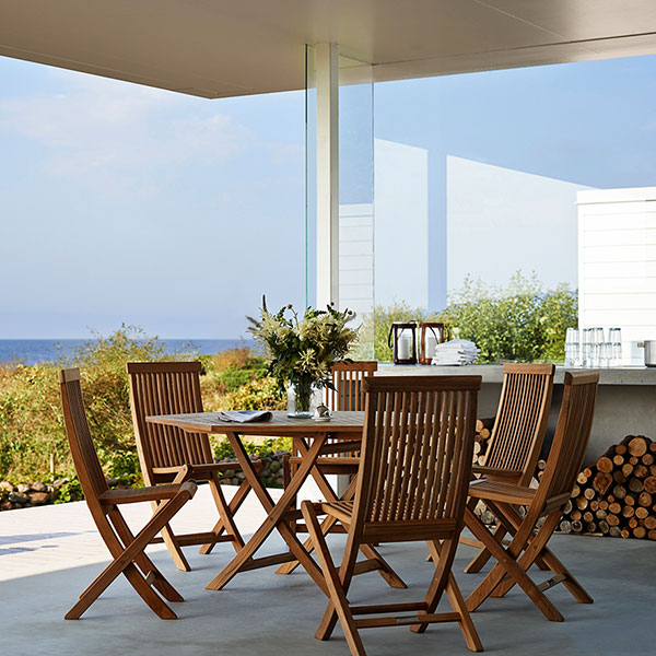 "take a break in the shade: six viken chairs surrounding the viken 55"" hexagonal dining table"