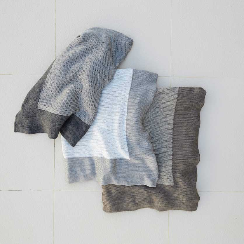 take me, or me, or me: cane-line stay-warm plaids in granite, dusty white and latte (color latte has been discontinued)