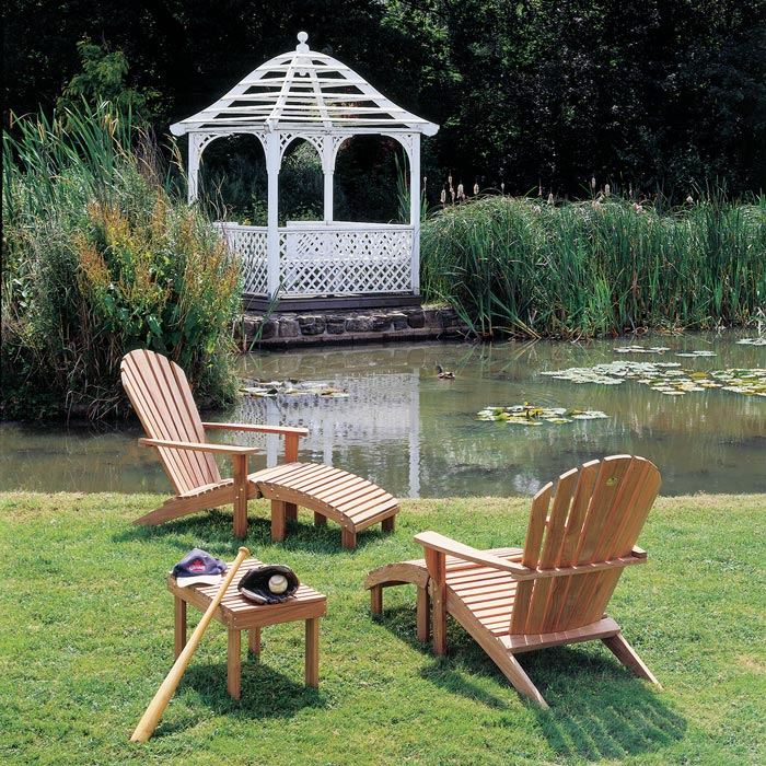 """arcadian: two adirondack armchairs with footrest and adirondack 25"""" side table near the pond"""