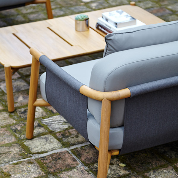 side view: hamp deep-seating armchair with plush seat and back cushions (throw pillow included in price)