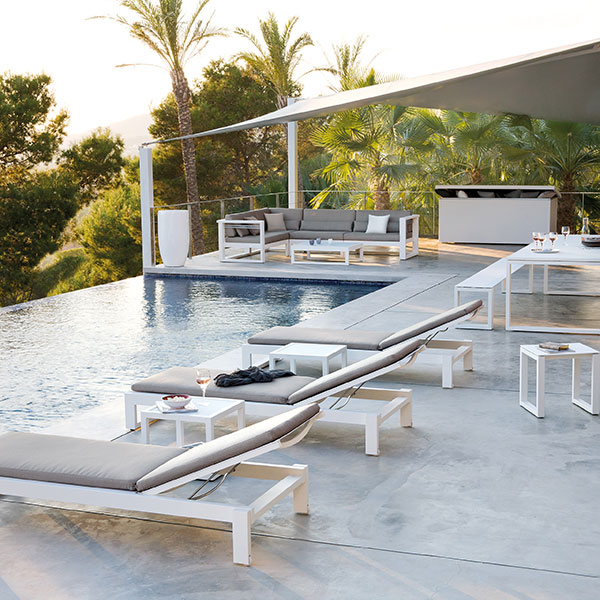 lounging, dining, and relaxing poolside all by manutti