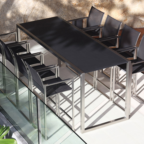 "take the high seat: eight ninix bar chairs (stainless steel | batyline black) lined up on the sides of the ninix 79"" bar table (stainless steel 