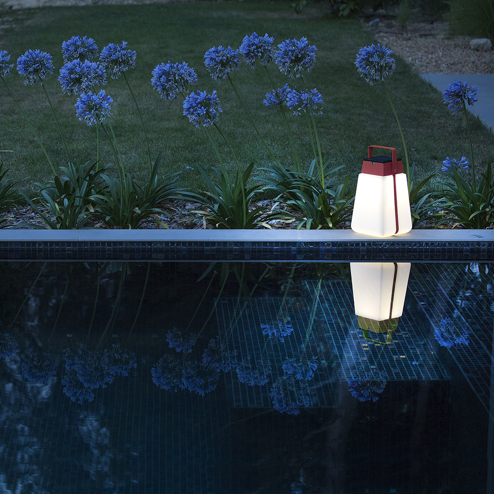set the ambiance: a single bump solar lantern illuminates your garden to put emphasis where you want it