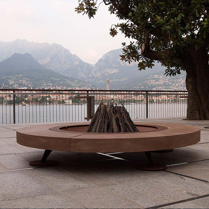 add some ambience to public spaces: ak47 design's rondo fire pit (italian stone & steel)