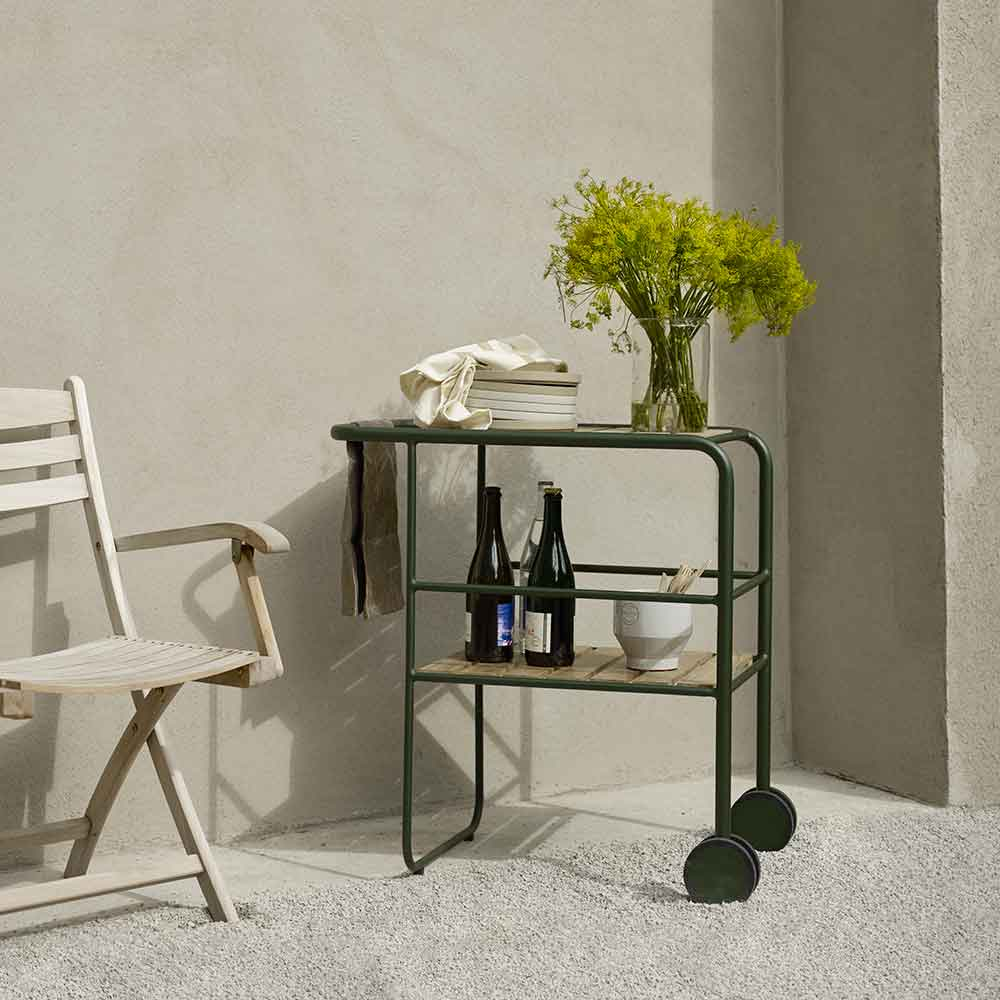 what is the accessory here? selandia folding armchair paired with skagerak's fuori serving trolley (finish: hunter green)