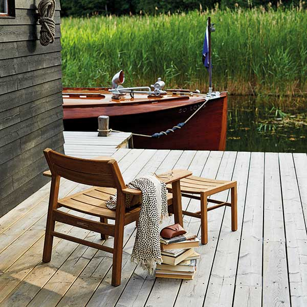 put your feet up and relax: djuro all-teak lounge armchair with djuro stool