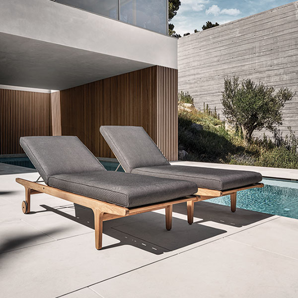 pair of bay loungers with wheels poolsideimage provided courtesy of gloster furniture, inc.