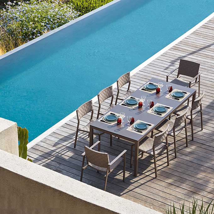two pheniks dining armchairs and six side chairs with kwadra dining table (available with glass or HPL top)