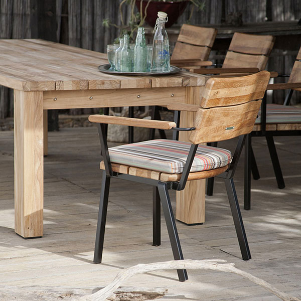 aging gracefully: titan rustic teak table and stacking rustic armchairs