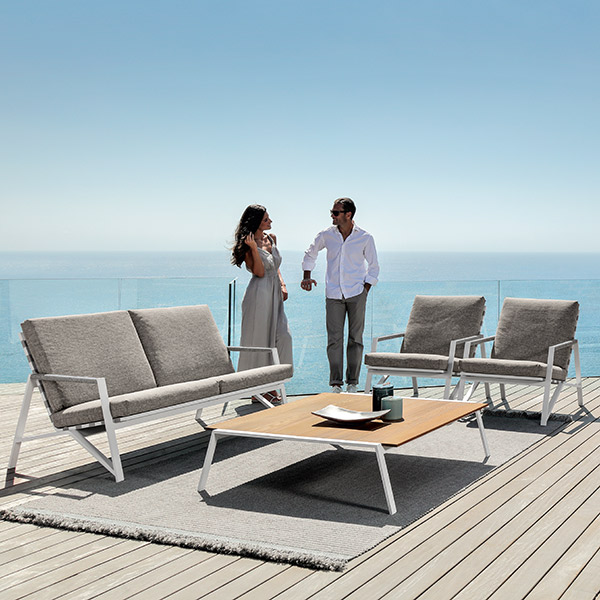 """modern outdoor lounge: cottage sofa and two living armchairs (frame white   cushion light grey) with 47"""" square coffee table (frame white   top iroko wood)"""