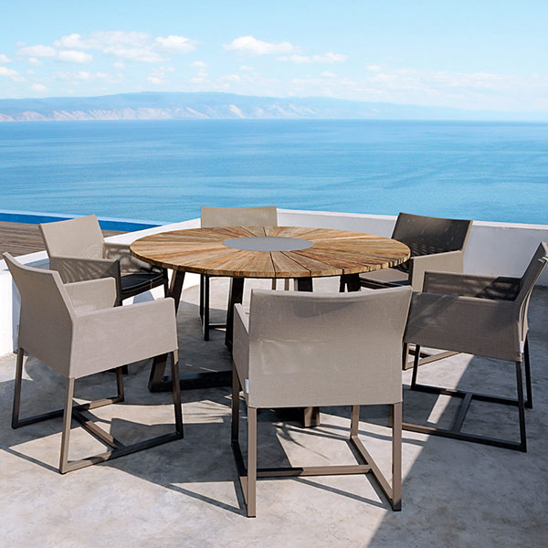 """baia 59"""" round dining table with taupe aluminum rotating center and paired with six mono dining armchairsimage provided courtesy of mamagreen, llc."""