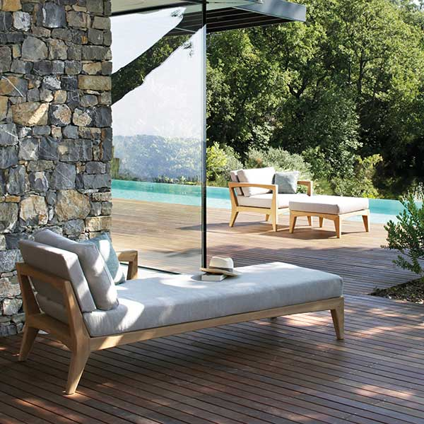 lounge in the shade or the sun: zenhit daybed (foreground) | zenhit armchair w/ footrest (background)