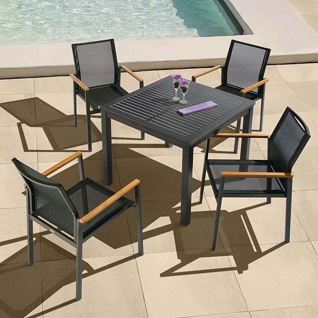 "light movable pool setting: aura 35"" square all aluminum dining table paired with four aura stacking armchairs (powder-coated aluminum frame, graphite 